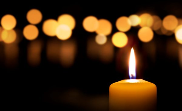 photo of candles lit in the darkness