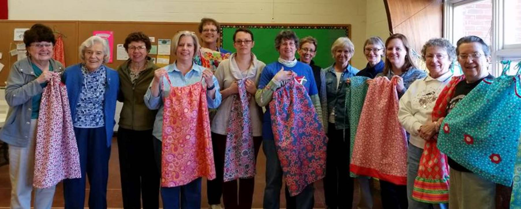 photo of FLC Women making aprons